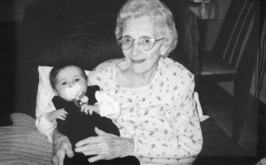 My great-grandmother holding my daughter.